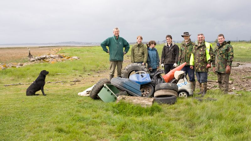 Wentloog Wildfowlers and Gwent Wildlife Trust members tidy up foreshore